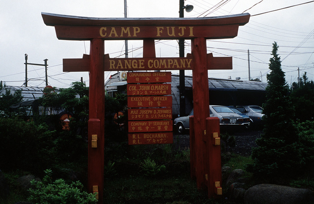 A typical organizational sign used by many Marine Corps units in Japan and Okinawa. Many of the signs only have the English spelling of the American names. Many other signs are like this one, that is, with the English and Japanese spelling of the names on the sign