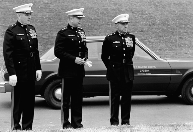 Lieutenant General Richard E. Carey (right), Commanding General of Marine Corps Development and Education Command, welcomes General P. X. Kelley, Assistant Commandant of the Marine Corps (center) and Major General David Twomey, Deputy for Education/Director, Education Center, before Quantico`s birthday pageant begins at Butler Stadium