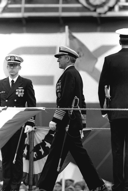 ADM Thomas B. Hayward, chief of naval operations, arrives for the commissioning ceremony aboard the nuclear-powered ballistic missile submarine USS OHIO (SSBN-726). The submarine was built by General Dynamics Corp