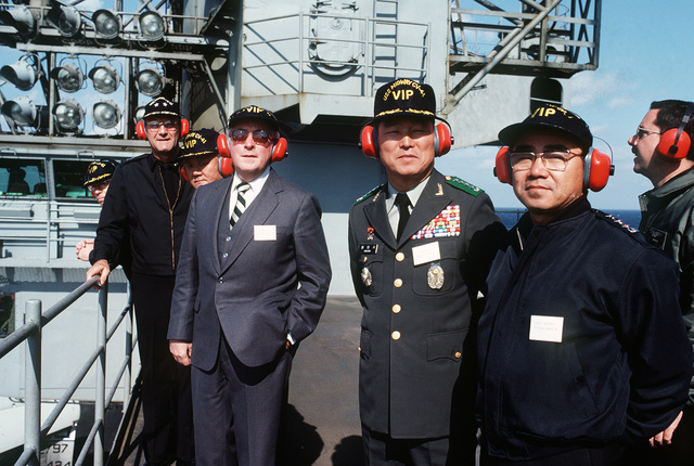 Among the distinguished guests touring the aircraft carrier USS MIDWAY (CV 41) are, left to right: Rear Admiral (RADM) James G. Storms III, commander, US Naval Forces Korea; Richard Walker, US ambassador to South Korea; General Hwang, Third Korean Army; and Vice Admiral Kyung Hwan Oh, commander Korean Fleet