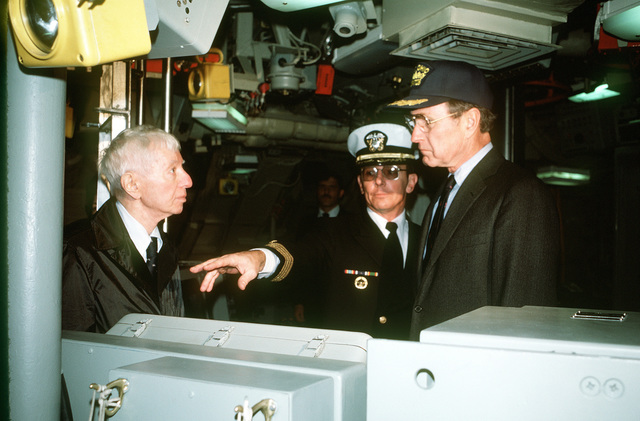 CAPT Alton K. Thompson, center, commanding officer (blue crew), gives ADM Hyman G. Rickover, left, deputy assistant secretary for naval reactors, Department of Energy, and Vice President George H. W. Bush a tour of the nuclear-powered ballistic missile submarine USS OHIO (SSBN-726) following the commissioning ceremony. The OHIO was built by General Dynamics Corp