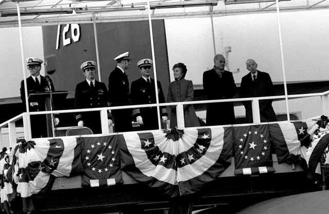 Distinguished guests on the speakers platform at the commissioning ceremony of the nuclear-powered ballistic missile submarine USS OHIO (SSBN-726) include, from right, ADM Hyman G. Rickover, deputy assistant secretary for naval reactors, Department of Energy; Sen. and Mrs. John Glenn (D-Ohio) and CAPT Alton K. Thompson, commanding officer (blue crew). Mrs. Glenn is the ship's sponsor