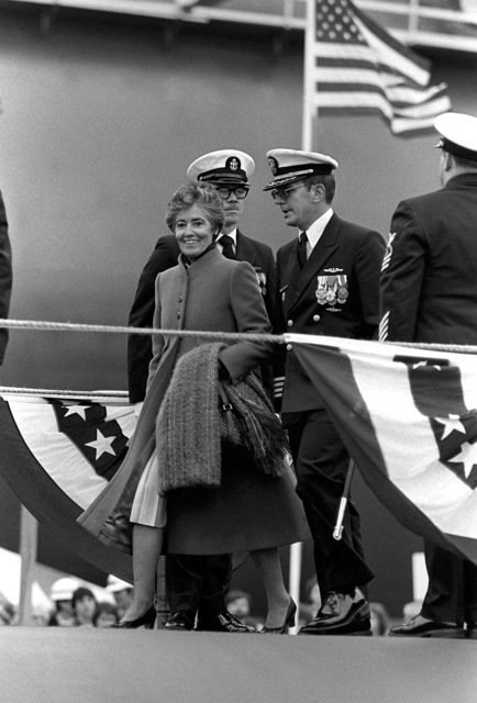 Mrs. John Glenn, ship's sponsor, is escorted by CAPT Alton K. Thompson, commanding officer (blue crew), during commissioning ceremony for the nuclear-powered ballistic missile submarine USS OHIO (SSBN-726). The submarine was built by General Dynamics Corp