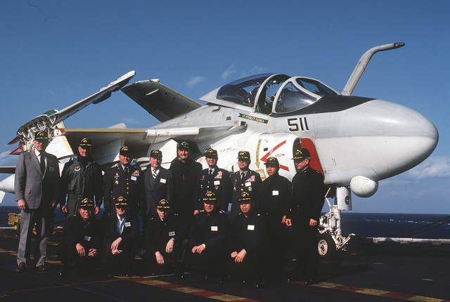 Richard Walker, left, US ambassador to South Korea, poses in front of an A-6E Intruder aircraft with distinguished Korean military personnel and other VIPs aboard the aircraft carrier USS MIDWAY (CV 41)