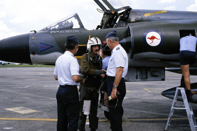 An Australian pilot is welcomed by officers participating in Exercise Cope Thunder as he disembarks a CA-29 Mirage aircraft