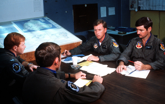 F-16 Fighting Falcon aircraft pilots hold a preflight briefing during exercise COPE ELITE '81. The pilots are from 428th Tactical Fighter Squadron, 474th Tactical Fighter Wing