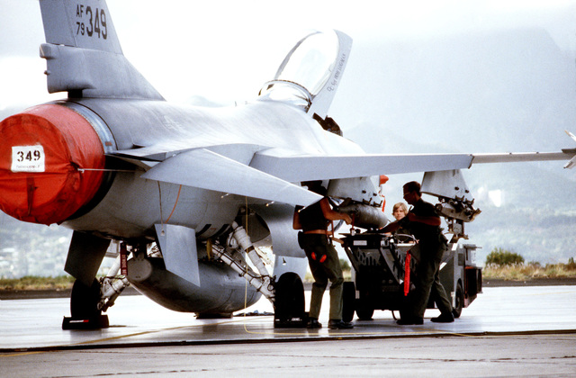 Ground crew members load a Mark 82 500-pound laser-guided bomb on an F-16 Fighting Falcon aircraft during exercise COPE ELITE '81