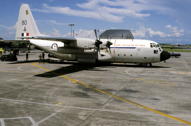 Right side view of a Royal Australian Air Force C-130 Hercules aircraft carrying support personnel and equipment for exercise Cope Thunder