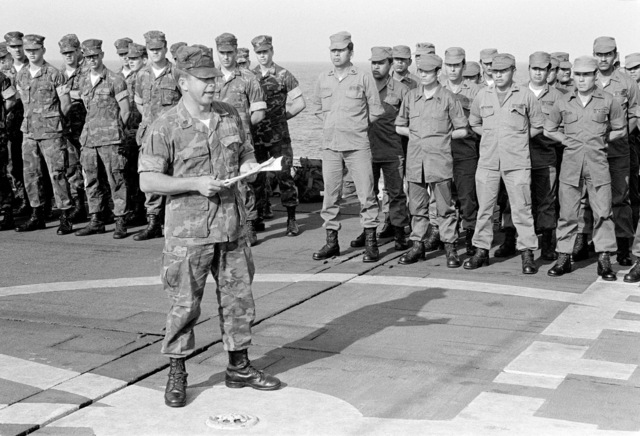 American and Ecuadorian Marines stand in formation aboard the dock landing ship USS PLYMOUTH ROCK (LSD-29) as GYSGT Offutt of the U.S. Marine Corps passes on information about the upcoming Operation Unitas XXII. Military men from many South American countries will be participating in the operation