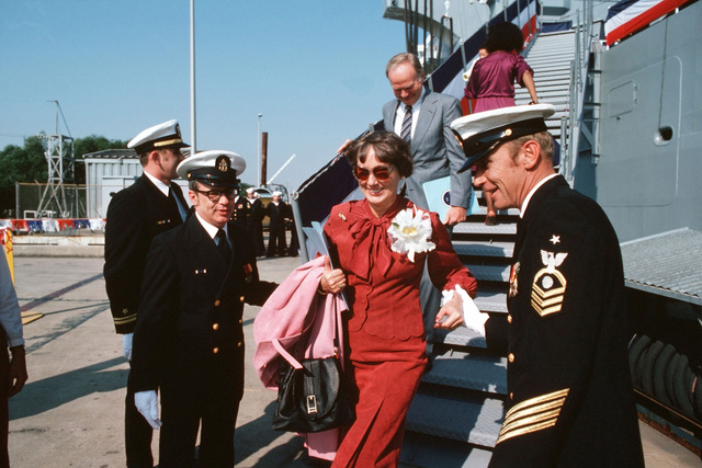 Barbara Griffiths, sponsor of the fleet oiler USS MERRIMACK (AO 179), and her husband retired Vice Admiral (VADM) Charles H. Griffiths, disembark after the ship's commissioning at Avondale shipyard