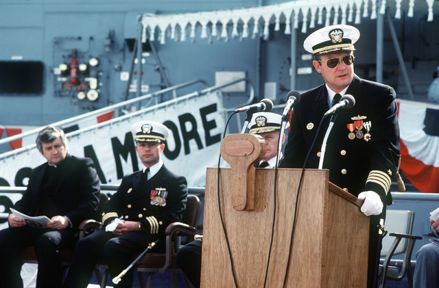 Captain David G. Kalb, Supervisor of Shipbuilding, Conversion and Repair, speaks during the commissioning ceremony for the Oliver Hazard Perry class guided missile frigate USS JOHN A. MOORE (FFG 19). Seated behind him is (left to right) the Reverend John Twomey, Commander Alan W. Swinger, prospective commanding officer, and Rear Admiral Paul T. Gillerist, commander, Naval Base San Diego