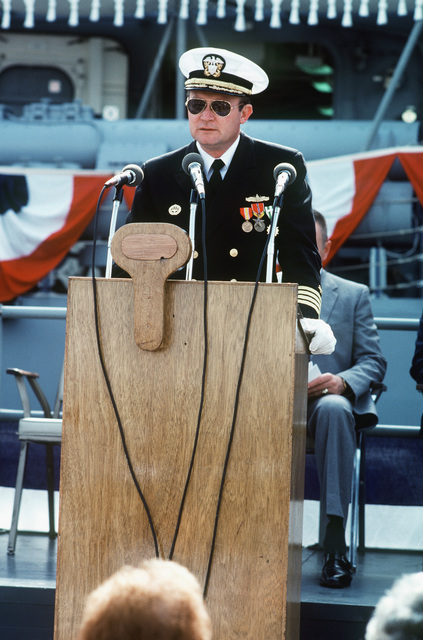 Captain David G. Kalb, Supervisor of Shipbuilding, Conversion and Repair, speaks during the commissioning ceremony for the Oliver Hazard Perry class guided missile frigate USS JOHN A. MOORE (FFG 19)