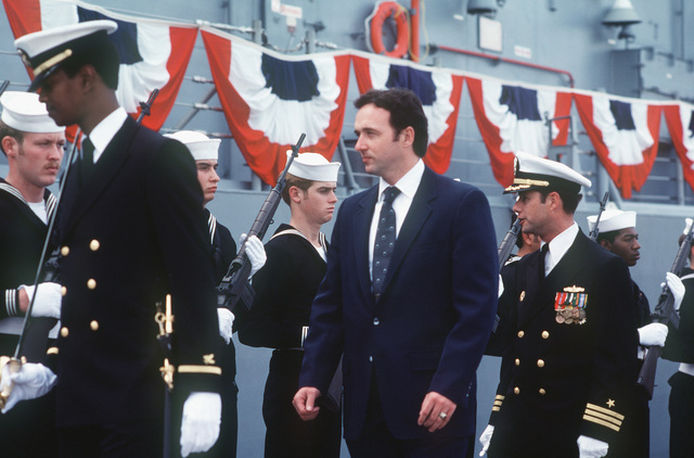 Congressman Dan Lungren, R-California, (center) and Commander Alan W. Swinger, prospective commanding officer, inspects the Navy honor guard, armed with M1 rifles, during the commissioning of the Oliver Hazard Perry class guided missile frigate USS JOHN A. MOORE (FFG 19)