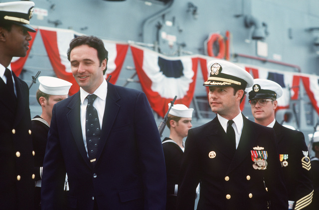 Congressman Dan Lungren, R-California, (second from left) and Commander Alan W. Swinger, prospective commanding officer (third from left) finish inspecting a Navy honor guard during the commissioning of the Oliver Hazard Perry class guided missile frigate USS JOHN A. MOORE (FFG 19)