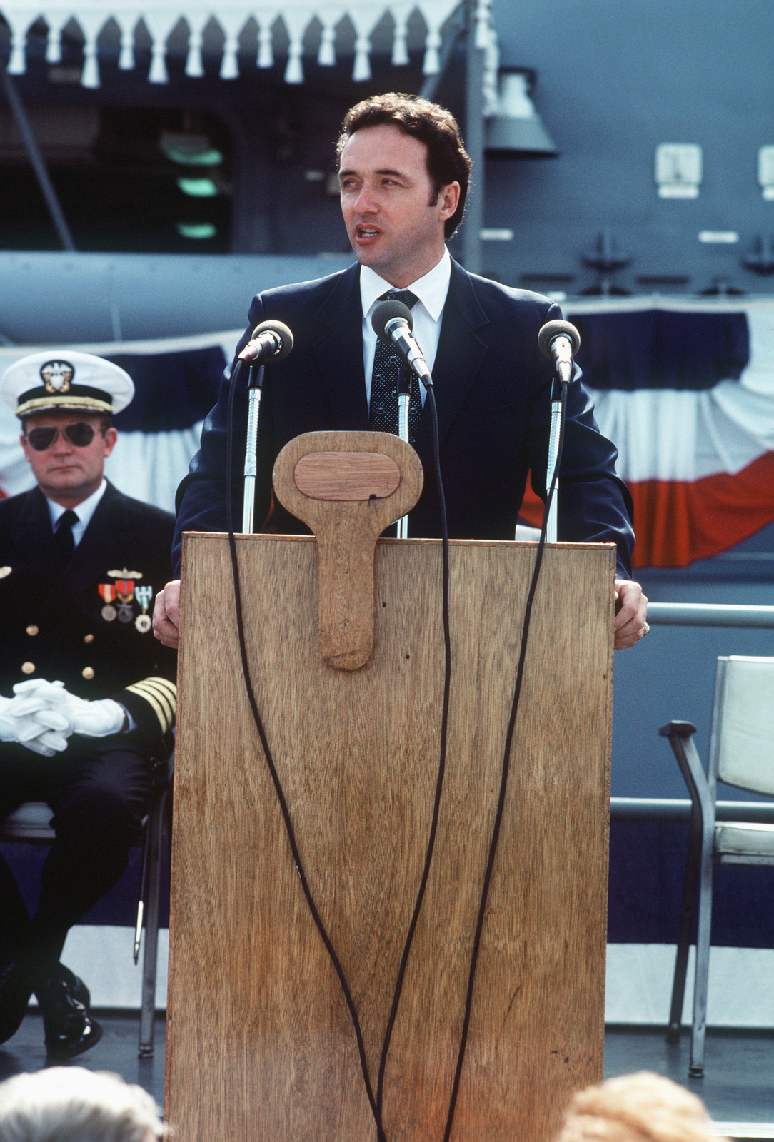 Congressman Dan Lungren (R-California) speaks during the commissioning ceremony for the Oliver Hazard Perry class guided missile frigate USS JOHN A. MOORE (FFG 19). Seated behind him is Captain David Kalb, Supervisor of Shipbuilding, Conversion and Repair