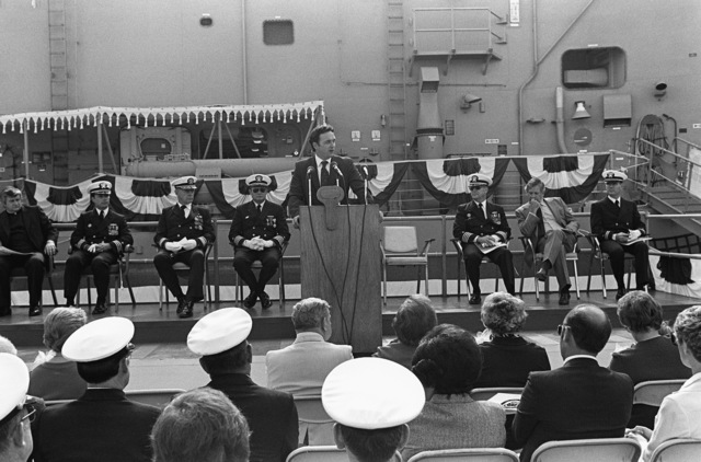 Congressman Dan Lungren (R-California) speaks during the commissioning ceremony for the Oliver Hazard Perry class guided missile frigate USS JOHN A. MOORE (FFG 19). Seated behind him, third from left, is Rear Admiral Paul T. Gillcrist, commander, Naval Base, San Diego, California