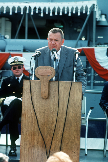 Len Thorell, vice president and general manager of Todd Pacific Shipyard, speaks during the commissioning ceremony for the Oliver Hazard Perry class guided missile frigate USS JOHN A. MOORE (FFG 19). Seated behind him is Captain David Kalb, Supervisor of Shipbuilding, Conversion and Repair