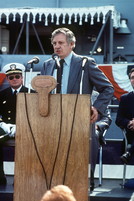 Mr. G. C. Jones speaks during the commissioning ceremony for the Oliver Hazard Perry class guided missile frigate USS JOHN A. MOORE (FFG 19). Seated behind him (left) is Captain David G. Kalb, Supervisor of Shipbuilding, Conversion and Repair, and Congressman Dan Lungren, R-California