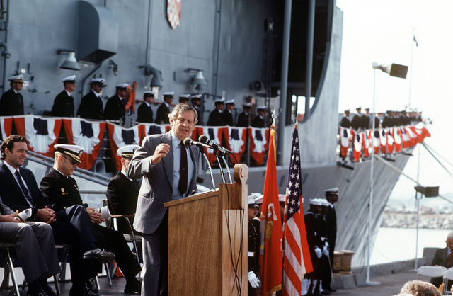 Mr. G. C. Jones speaks during the commissioning ceremony for the Oliver Hazard Perry class guided missile frigate USS JOHN A. MOORE (FFG 19). Seated behing him Congressman Dan Lungren (R-California) (second from left)