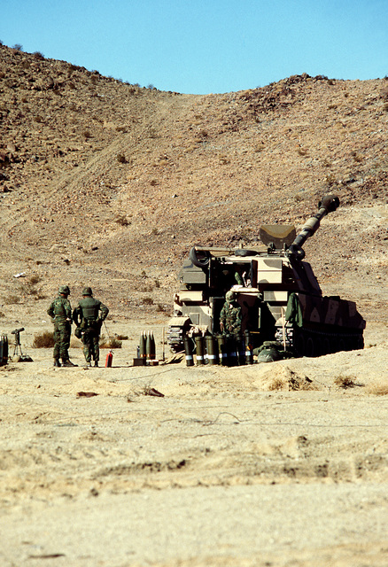 Combat-ready Marines of this M-109A2 155mm self-propelled howitzer section stand by for the next fire mission during Operation CAX 1-2-82 at the Marine Corps Air-to-Ground Combat Center