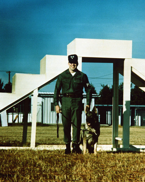 """SPC Daniel Powers and his dog """"Baron"""", of the 16th Military Police Brigade, at the Military Working Dog Facility"""