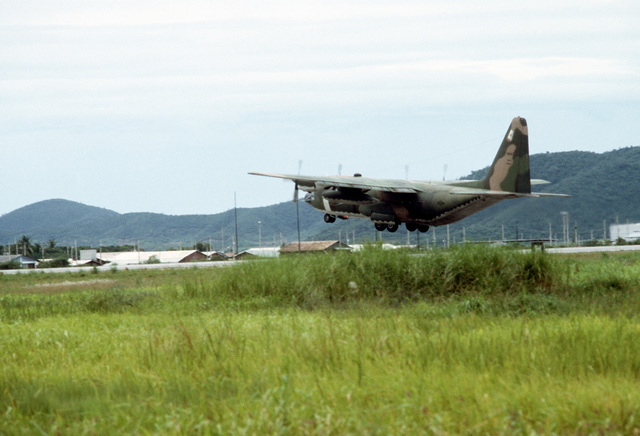 A view of a C-130 Hercules aircraft of the 21st Tactical Airlift Squadron landing. A combat control team is participating in a joint parachute training exercise with Thai forces