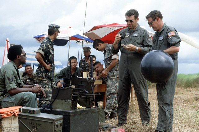 Combat control team (CCT) members and their Thai counterparts perform airdrop control procedure in a drop zone. The CCT is from the 374th Tactical Airlift Wing, involved in a joint parachute training exercise with Thai forces