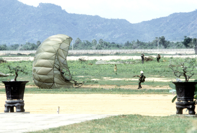 Paratroopers land after jump from a C-130 Hercules aircraft. Members of Thai forces are involved in a joint parachute training exercise with a United States Air Force combat control team