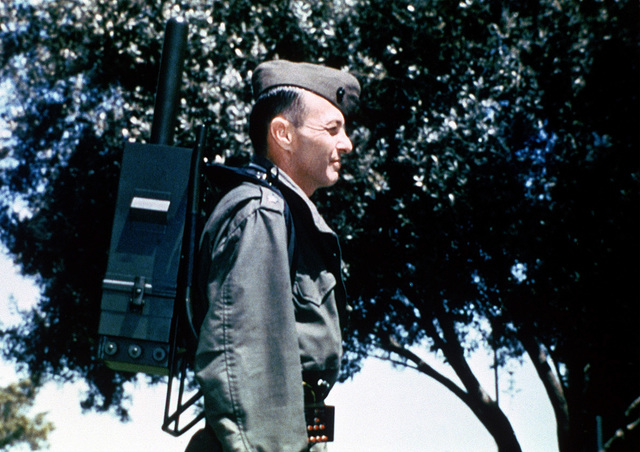 A Marine wears a backpack, part of the Navstar Global Positioning System satellite