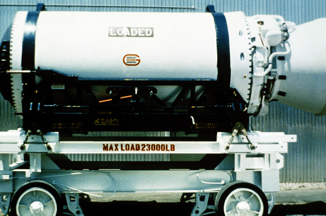 A portion of a Minuteman laser guided missile 30 is loaded on a transport vehicle