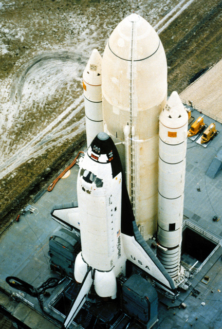 Aerial view of the rocket booster-mounted Columbia space shuttle orbiter on a launch pad