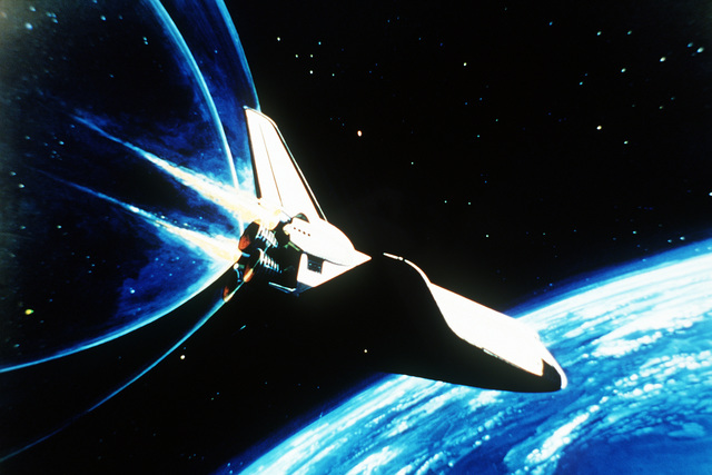 Artist's view of the space shuttle orbiter in orbit, with the earth in the background