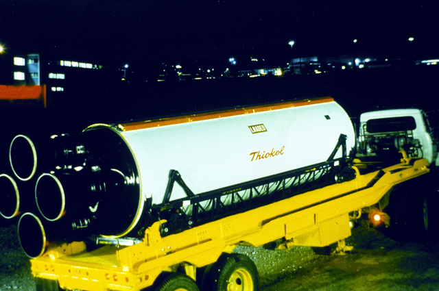 Night view of a Minuteman (LGM-30) first stage loaded on a flatbed trailer