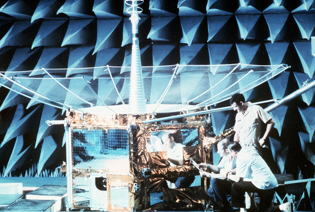 Technicians work on the Fleet Satellite Communications satellite in the TRW laboratory