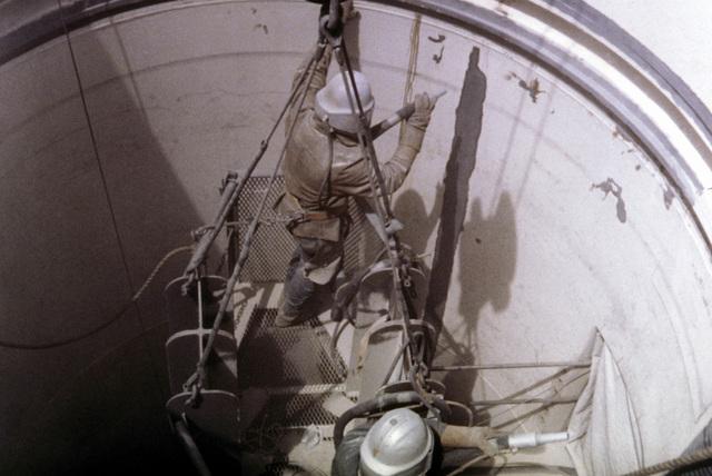 Worker sprays inside of Minuteman (LGM-30) silo wall