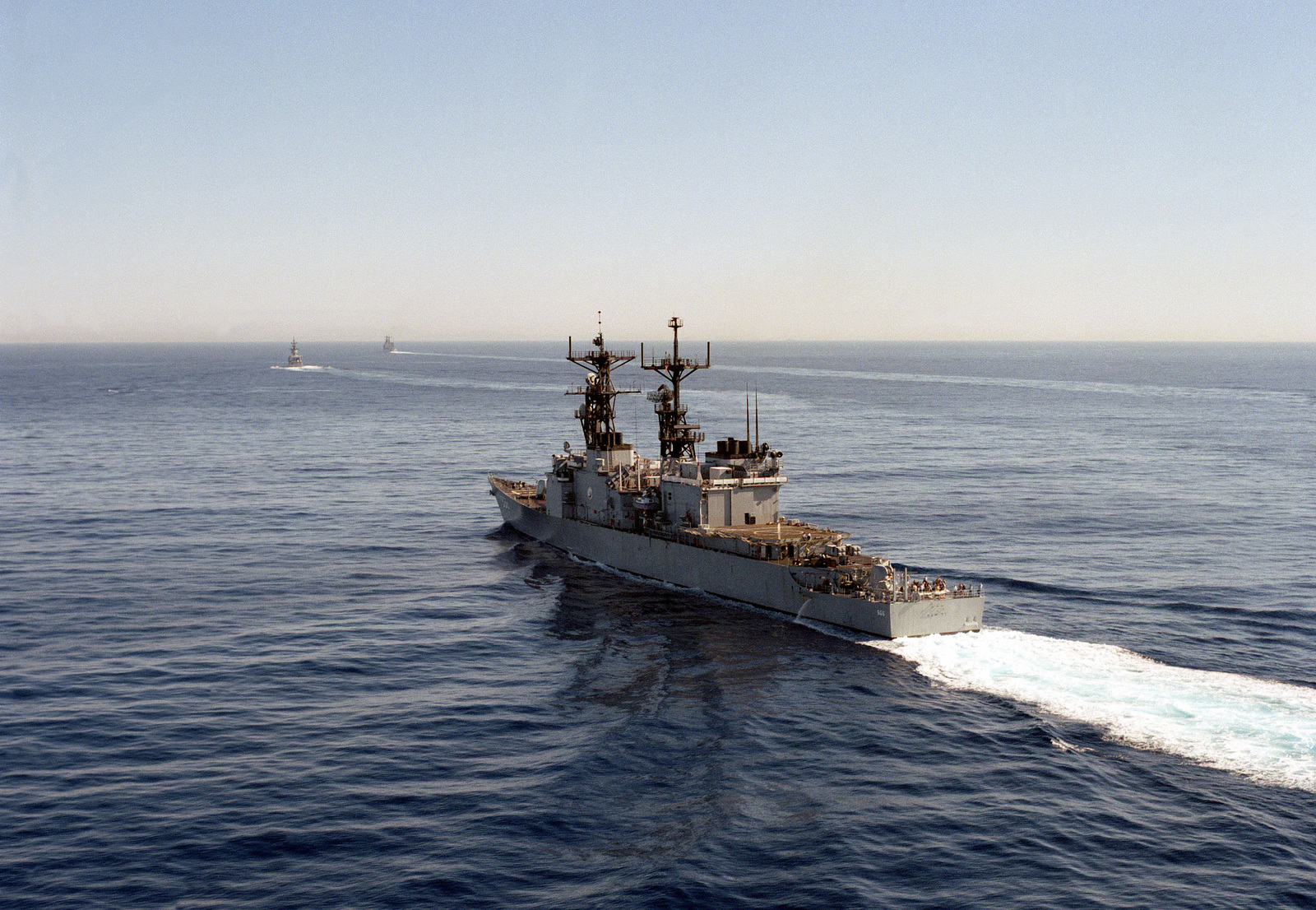 A port quarter view of the destroyer USS HEWITT (DD 966) underway off the coast of San Diego, California