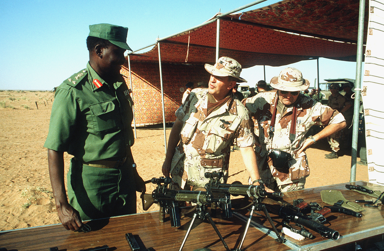 A high ranking Sudanese officer, left, and two Army colonels examine German built 7.62 mm G3 Heckler and Koch rifles on display during BRIGHT STAR '82, an exercise involving troops from the US, Egypt, Sudan, Somalia and Oman