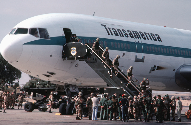 A left front view of a chartered Transamerica DC-10 aircraft as members of the 82nd Airborne Division debark upon their arrival to participate in Exercise BRIGHT STAR '82
