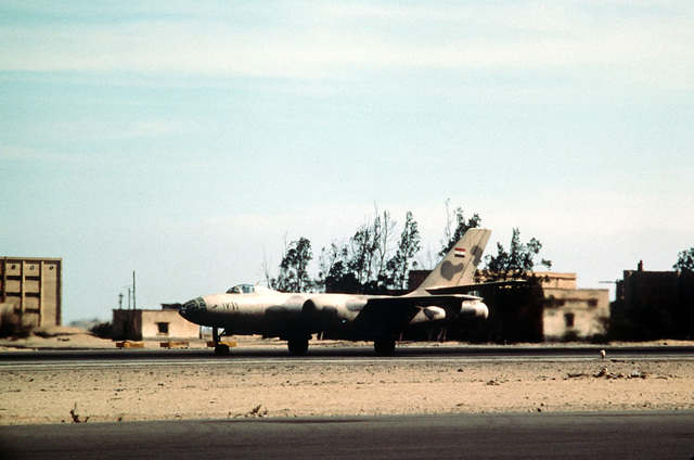 A left front view of an Egyptian (Soviet built) MiG-15 aircraft parked on a flight line
