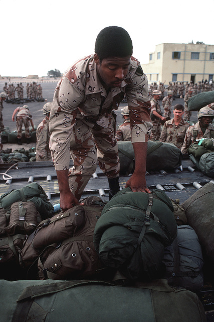 A member of the 82nd Airborne Division prepares gear for loading aboard an aircraft, at the conclusion of Exercise BRIGHT STAR '82