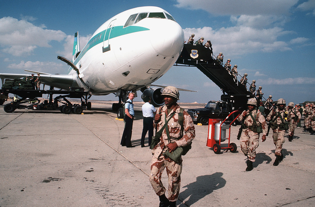 A right front view of a chartered Transamerica DC-10 aircraft as members of the 82nd Airborne Division debark upon their arrival to participate in Exercise BRIGHT STAR '82