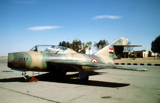A right front view of an Egyptian (Soviet built) MiG-15 aircraft parked on a flight line