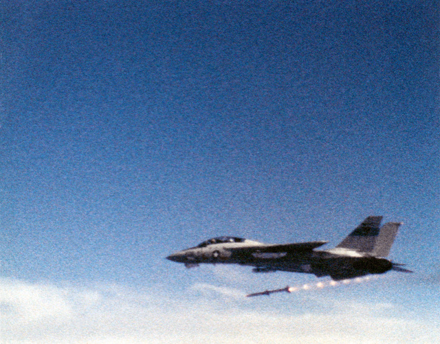 An advanced medium range air-to-air missile (AMRAAM) after its launch from an F-14A Tomcat aircraft, near the Pacific Missile Test Center (PMTC), Point Mugu, California. (Substandard image)