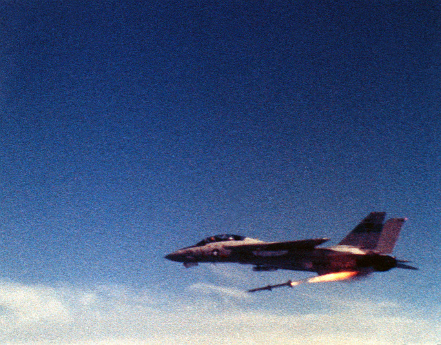 An Advanced Medium Range Air-to-Air Missile (AMRAAM) during its launch from an F-14A Tomcat aircraft, near the Pacific Missile Test Center (PMTC), Point Mugu, Calif