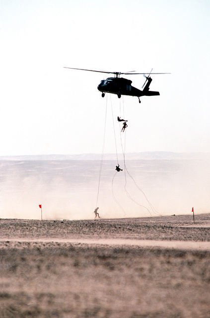 US soldiers rappel from a UH-60 Black Hawk (Blackhawk) helicopter as a combined armaments live fire exercise takes place during BRIGHT STAR '82, an exercise involving troops from the US, Egypt, Sudan, Somalia and Oman
