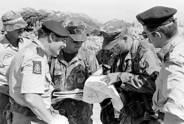 During a briefing U.S. Marine CPT Allan Bacon uses a terrain map to show their positions to his commanding officer and two Netherland Marine officers. They are participating in Operation Unitas XXII. The U.S. Marines are from Co. K, 3rd Bn., 6th Marines
