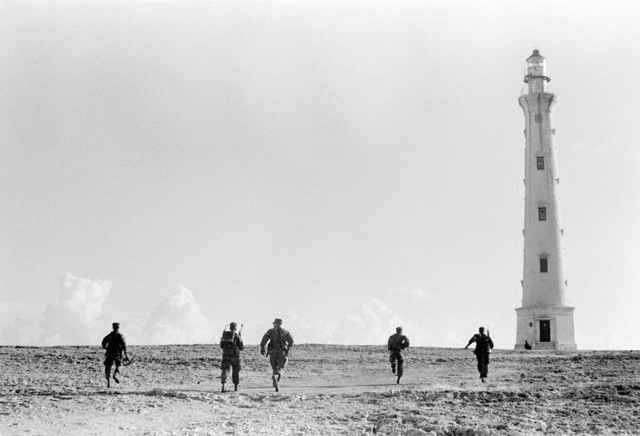 Members of the 2nd Plt., Co K, 3rd Bn., 6th Marines, run toward their objective (light house) during Operation Unitas XXII. Dutch marines are also participating in this operation