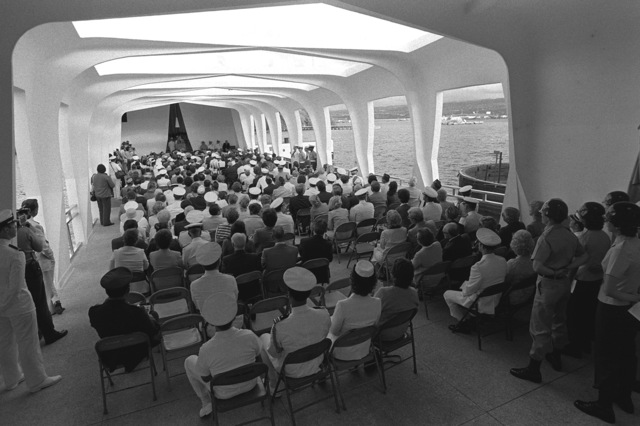 A back view of the guests attending the ceremony aboard the USS ARIZONA Memorial commemorating the 40th anniversary of the Japanese attack on Pearl Harbor