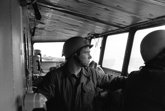 Lieutenant Michael Freeman, executive officer, directs a general quarters drill from the bridge of the salvage ship USS OPPORTUNE (ARS 41) on the 40th anniversary of the attack on Pearl Harbor