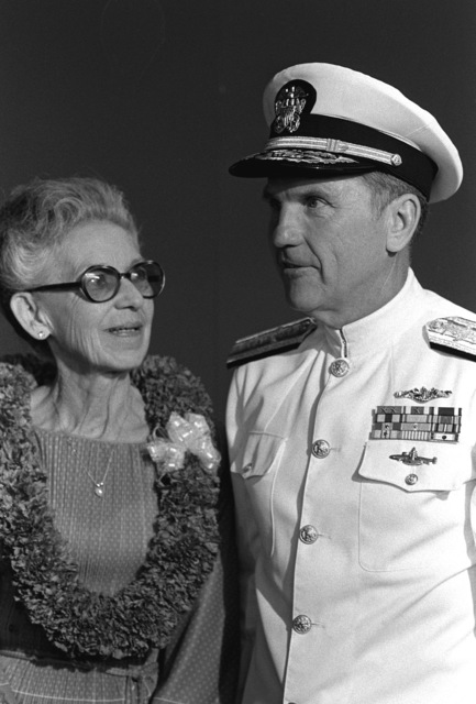 RADM Stanley J. Anderson, commander, Naval Base, Pearl Harbor, stands with Edith Susnir, an honored guest, during a memorial service aboard the USS ARIZONA Memorial commemorating the 40th anniversary of the Japanese attack on Pearl Harbor